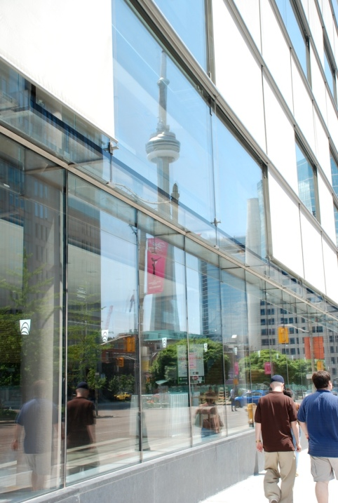 The CN Tower, as reflected in a downtown office block.